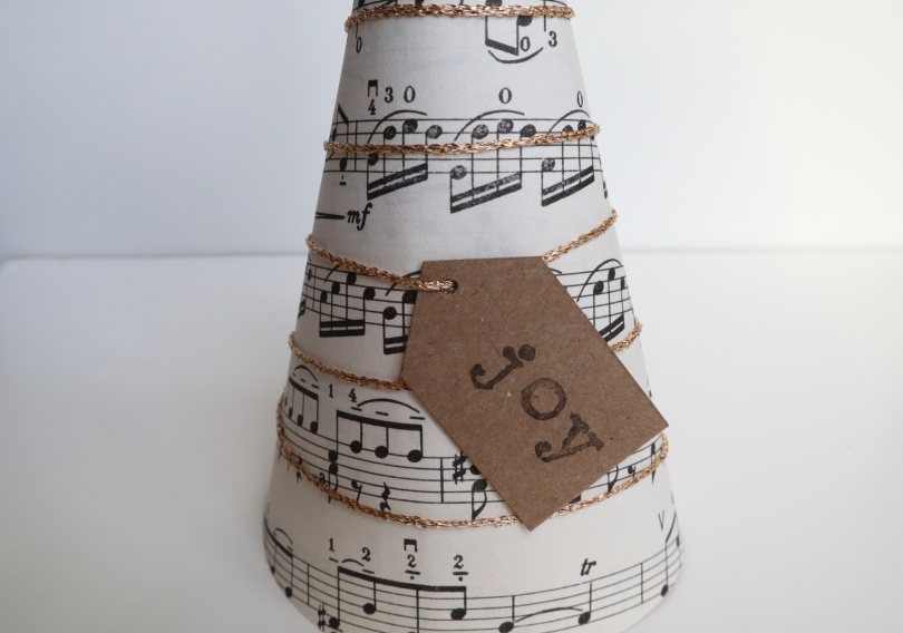 Paper tree sticking label to cone