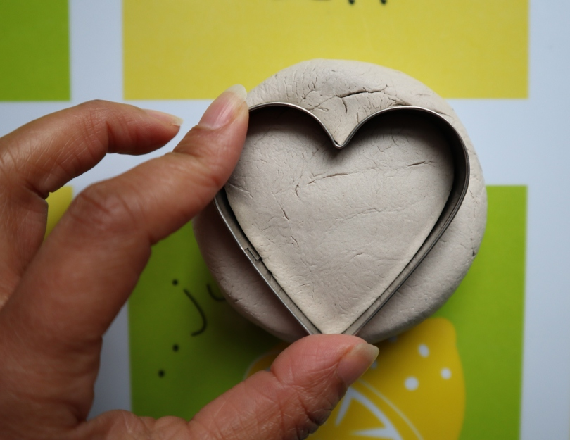 Clay candle holder cutting heart shape