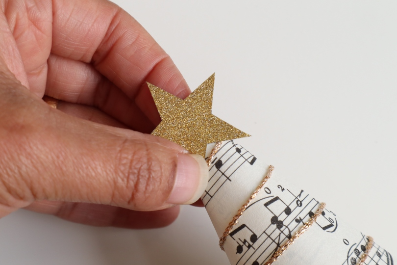 Paper tree sticking star on